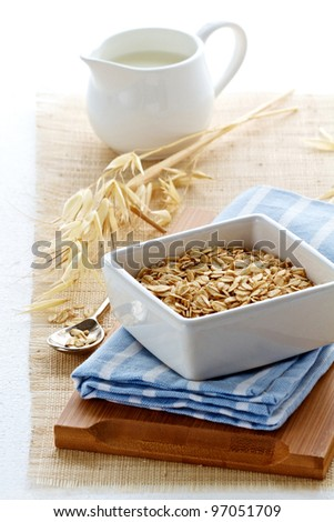 Oats and milk for breakfast - stock photo