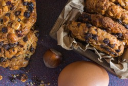 oats cookies with hazelnuts and chocolate chips and an egg