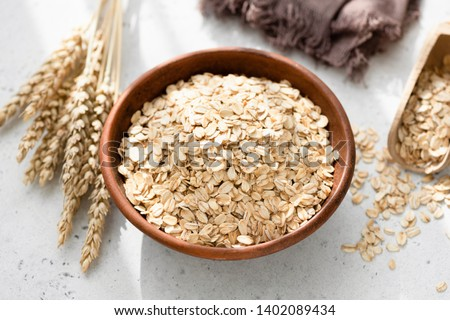 Oats or rolled oats or oat flakes in bowl. Healthy eating, healthy lifestyle, dieting and weight loss concept