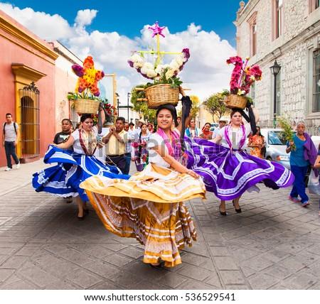 OAXACA, MEXICO-DEC 10, 2015: Beautiful ladys celebrating Day of the Virgin of Guadalupe (Dia de la Virgen de Guadalupe) on Dec 10, 2015 . Oaxaca, Mexico. It is a popular Catholic feastival