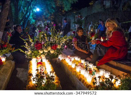 OAXACA , MEXICO - NOV 02 : Unidentified people on a cemetery during Day of the Dead in Oaxaca, Mexico on November 02 2015. The Day of the Dead is one of the most popular holidays in Mexico