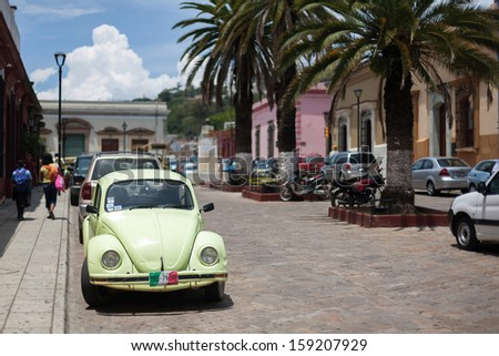 OAXACA, MEXICO - SEN 08: Old cars on the street of Oaxaca, Mexico, 08 September 2012. The city architecture of Oaxaca is protected by UNESCO