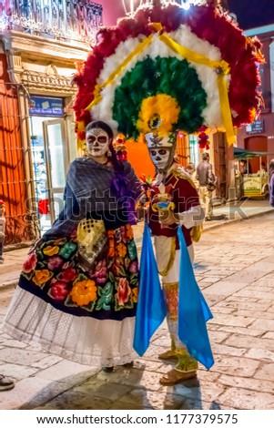 Oaxaca, Oaxaca / Mexico - November 2 2014: couple ready for dia de los muertos #1177379575