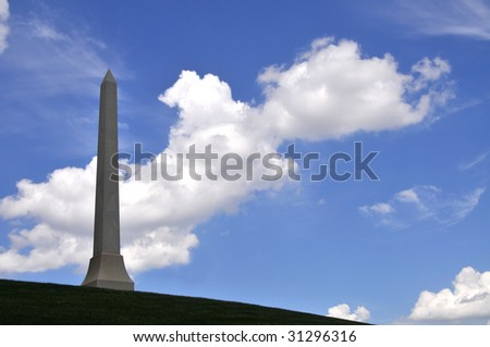 Obelisk on a hill against sky, shot of a gravestone at the Arlington National Cemetery in Arlington, Virginia, near Washington DC - stock photo