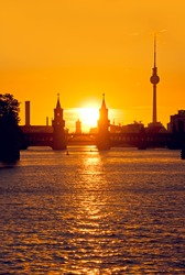 oberbaumbruecke bridge in berlin kreuzberg at sunset