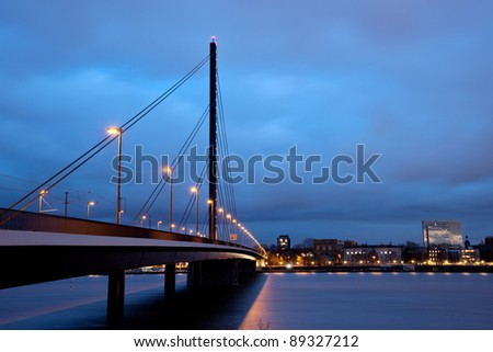 Oberkasseler bridge above Reine river in downtown Dusseldorf, Germany