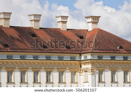 OBERSCHLEISSHEIM, GERMANY - SEPTEMBER 6, 2016  New Schleissheim palace built in early XVIII century, detail of the facade in Renaissance style, the tiled rood and the decorated chimneys