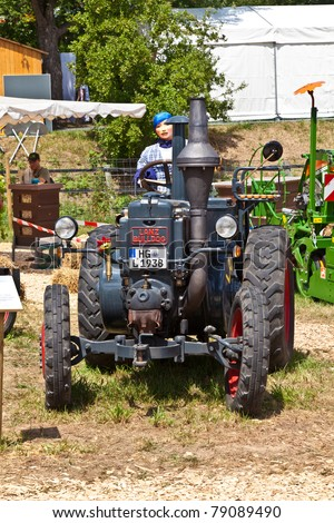 OBERURSEL, GERMANY - JUNE 12: old tractors at the Hessentag on June 12, 2011 in Oberursel, Germany. Hessentag is a big festival to present a city in the county of Hesse in Germany.