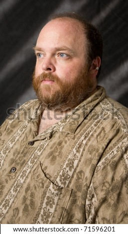 obese middle aged man posing in studio shot