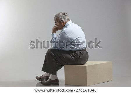 Obese old man thinking
