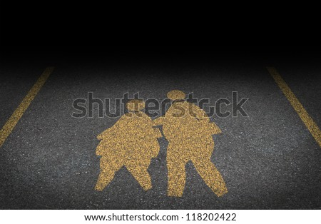 Obesity in children and childhood obese concept with a yellow painted asphalt road sign as an icon of overweight kids and students as a warning to the hazards of eating junk food and fatty fast food.
