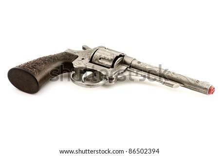 object on white - toy revolver close up
