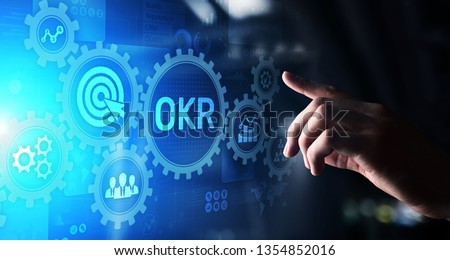 Objective Key Results Business technology process improvement concept on virtual screen.