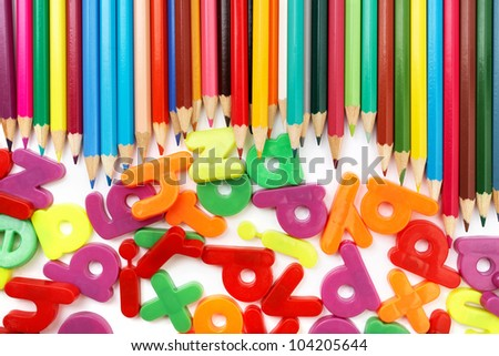 Objects for kids in kindergarten: color pencils and magnets