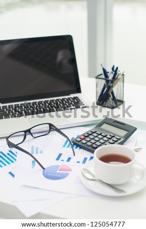 Objects on the businessman�¢??s table