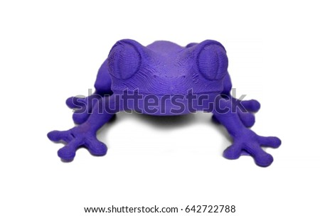Objects printed by 3d printer Isolated on white background. Bright colorful object. Toad purple color. Automatic three dimensional performs plastic modeling. Modern 3D printing technology.