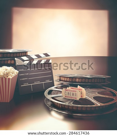 Objects related to the cinema on reflective surface.