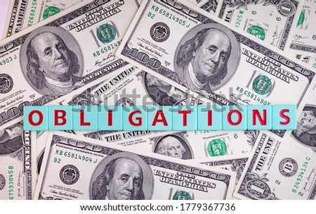 Obligations word on a dollars background, business concept. Stock foto ©