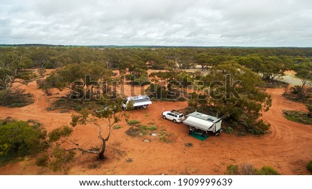 Oblique aerial view of 4WD and modern caravan camped at a free camping area in the outback in Australia. Foto stock ©