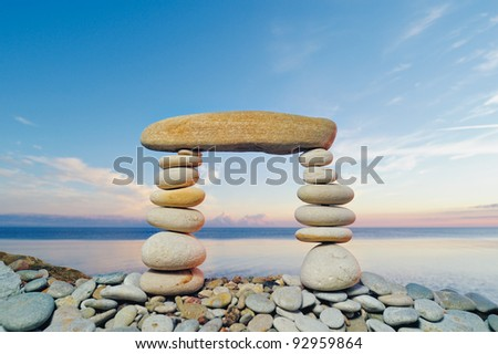 Oblong horizontal stone between a piles of pebble