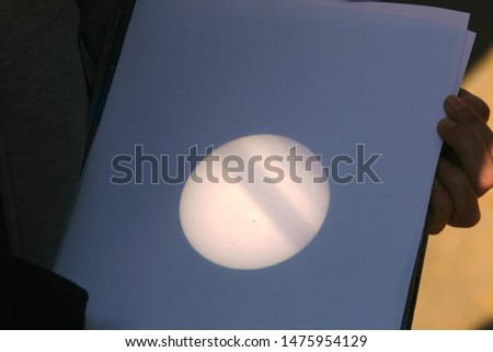 Observation of Mercury transit across the disk of the Sun by projecting image through a refracting telescope to a piece of white paper. An interesting and safe amateur astronomy observation technique