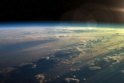 Observation of the planet Earth from space. On the surface of the planet are visible clouds. Earth's atmosphere. Elements of this image furnished by NASA.