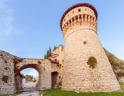 Observation tower and drawbridge of the castle of Brescia city. Lombardy, Italy