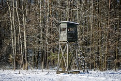 Observation turret on the edge of winter forest
