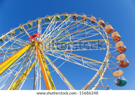 observation wheel under blue sky