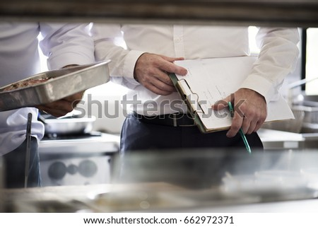 Observer in a kitchen with chef