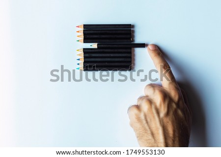 Obsessive compulsive disorder, male hand obsessively ordering some colored pencils Conceptual psychological problem, OCD Stock photo ©