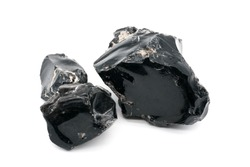 Obsidian stones on white background. Iceland volcanic rocks. Shiny stones. Stones which could kill white walkers . Black mineral - gems. Obsidian rock. Volcanic material. Rough edges. Sharpest rock