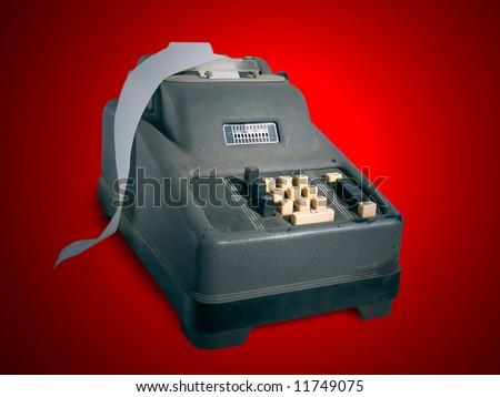 Obsolete adding machine on a red background
