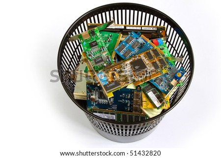 Obsolete computer parts in a bin over white background