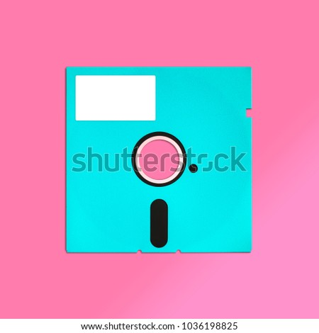 Obsolete floppy disk 5.25 inch, isolated and presented in punchy pastel colors with a blank white customizable label. Nostalgic theme of early computer storage media for factual work & creative design