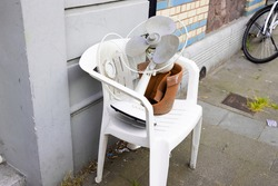 Obsolete items set on the street to be picked up by strangers for free. Getting rid of junk, recycling concept.