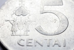 Obsolete Lithuanian 5 cent coin macro detail with Centai word. Lithuanian 5 cent coin macro view. European currency extreme close up. Shallow depth of field.