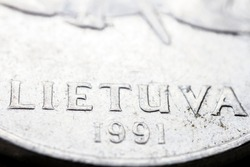 Obsolete Lithuanian 5 cent coin macro detail with Lietuva word. Lithuanian 5 cent coin macro view. European currency extreme close up. Shallow depth of field.