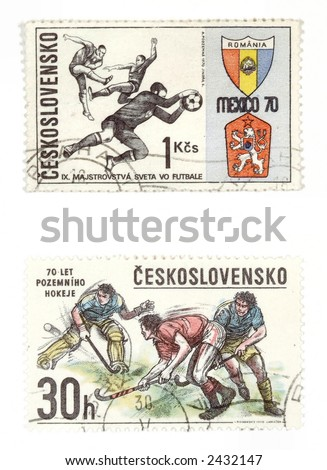Obsolete postage stamps from Czechoslovakia showing soccer and hockey - stock photo