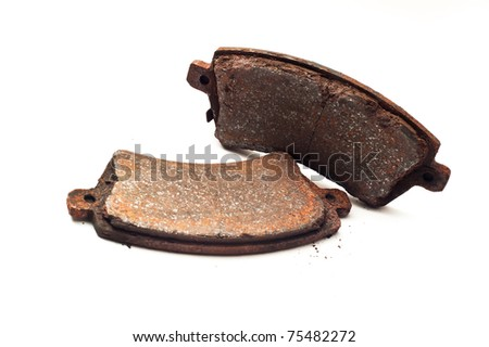 Obsolete rusty car brake bads isolated on white background