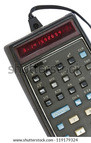 Obsolete technology. Old electronic scientific personal calculator with LED display readout and power plug, displays the number pi. Popular with high school, college math and science students.