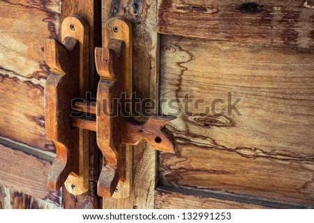 Obsolete wooden door bolt, Thai tradition
