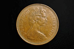 Obverse of the British two pence bronze 2 coin from 1971 with Queen Elizabeth II 1, close-up on dark background