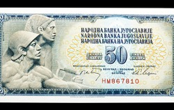 Obverse of uncirculated 50 dinars paper bill issued by Yugoslavia, that shows miners