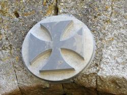 Occitan cross (Cathar cross) over a door in  medieval La Couvertoirade (Larzac France)
