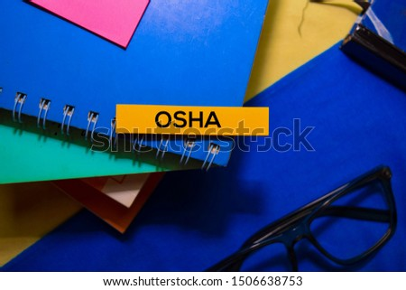Occupational Safety and Health Administration (Osha) on sticky Notes isolated on Office Desk Background.