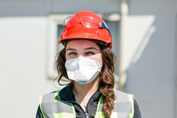 Occupational safety and health specialist with face mask for coronavirus (covid-19). Occupational health is a multidisciplinary field of healthcare concerned with enabling an individual.