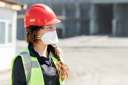 Occupational safety and health worker with face mask for coronavirus (covid-19). Specific occupational safety and health risk factors vary depending on the specific sector and industry.