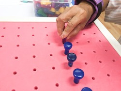 Occupational Therapy - Exercising with peg board. hand function training for stroke patient.