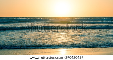 Ocean and beach at sunset. California Coast. Abstract seascape background. Original film shot.